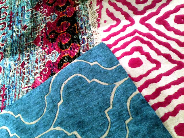 What's underfoot this month? Layers upon layers of patterned area rugs! - McNabb & Risley