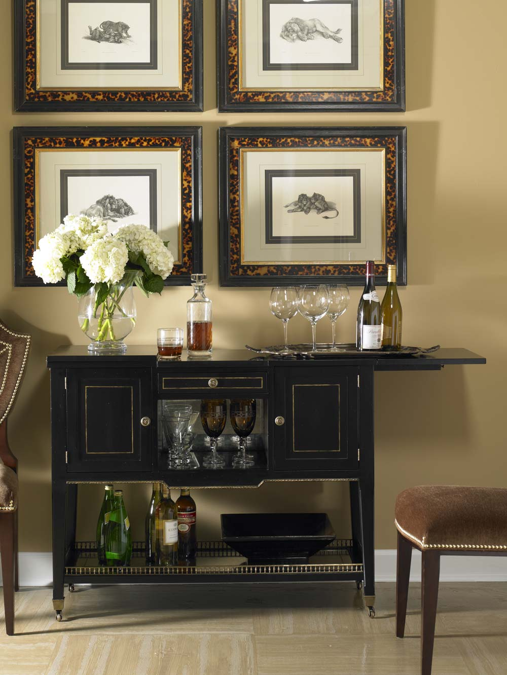 One of the hottest trends in design is the return of the mobile bar, and I love the one featured below! - McNabb & Risley
